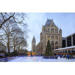 London, South Kensington, the Winter ice rink in front of the Natural History Museum. 10 inch Photo. London, South Kensington, the Winter ice rink.