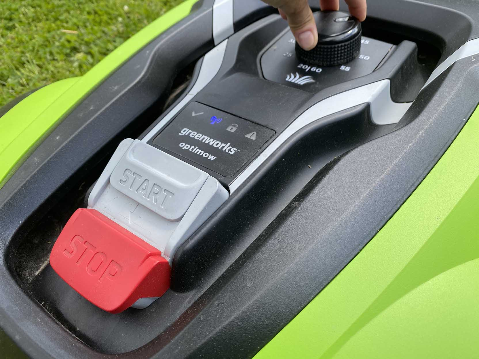 The GreenWorks Optimow 10 has no display, but you can undo the chassis and then wash off the robotic lawn mower