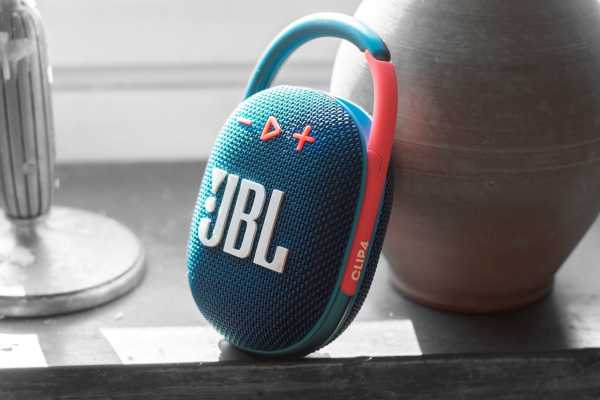 The JBL clip 4 has distinct buttons and a clear logo.