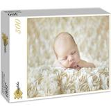 Jigsaw Puzzles Grafika Baby sleeping in the roses 300 Pieces